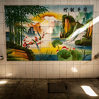 An idyllic mural on the way to the coal mine elevator shaft in the Jin Hua Gong Coal Mine, Shanxi Province, China. China's Ministry of Land and Resources has committed over 10 billion dollars to reclaim lands damaged by coal mining and to treat coal mining waste nationwide.