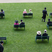 Race goers relax before the start of the races at Royal Ascot Race Course. Royal Ascot is one of the most famous race meetings in the world, frequented by Royalty and punters from the high end of society to the normal everyday working class. Royal Ascot 2009, Ascot, UK, on Wednesday, June 17, 2009. Photo Tim Clayton.