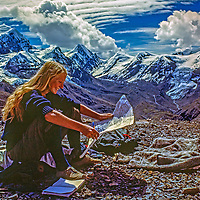 Meredith Wiltsie reads a map atop 17,769-foot Thorang La pass north of Annapurna in Nepal.