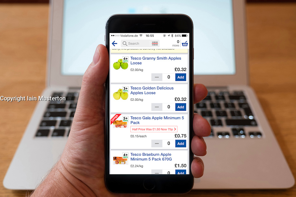 Using iPhone smartphone to display Tesco Groceries online shopping app