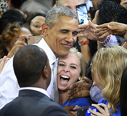 US President Barack Obama delights a Hillary Clinton supporter with a hug during a rally for the Democratic presidential nominee at the University of Central Florida on Friday, Oct. 28, 2016, in Orlando, FL, USA. Photo by Joe Burbank/Orlando Sentinel/TNS/ABACAPRESS.COM  | 569080_006 Orlando Etats-Unis United States