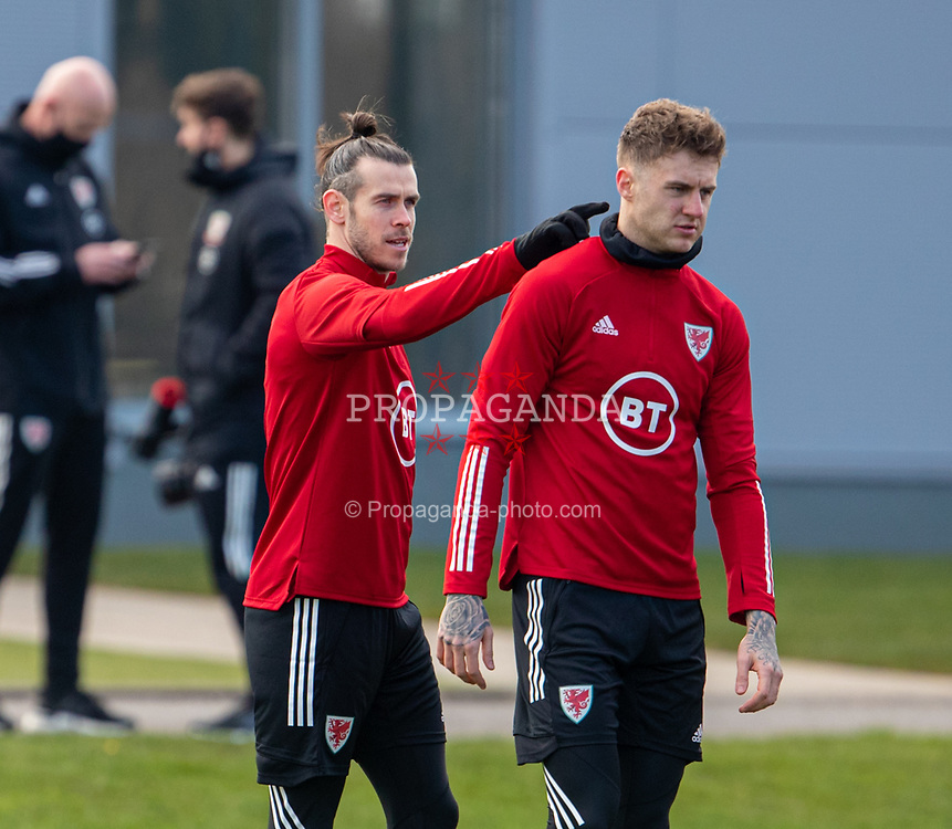 CARDIFF, WALES - Tuesday, March 23, 2021: Wales' captain Gareth Bale (L) and Tottenham Hotspur team-mate Joe Rodon during a training session at the Vale Resort ahead of the FIFA World Cup Qatar 2022 Qualifying game against Belgium. (Pic by David Rawcliffe/Propaganda)