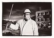 Mohamed de l'entreprise Bitz sur le chantier de la démolition Casino à Sion en 2020<br /> coronavirus covid 19,<br /> Projet sur la construction avec l'AVE (association Valaisanne des Entrepreneurs <br /> Suisse, Valais<br /> Project terre rare #photoargentique #noiretblanc #noiretblancphotographie #blackandwhite #blackandwhitephotography #photoargentique #photographieargentique #leica #leicamp #ilford #labophoto #terrerare #terresrares #terrerareprojet @omaire. <br /> (STUDIO_54/ OLIVIER MAIRE)