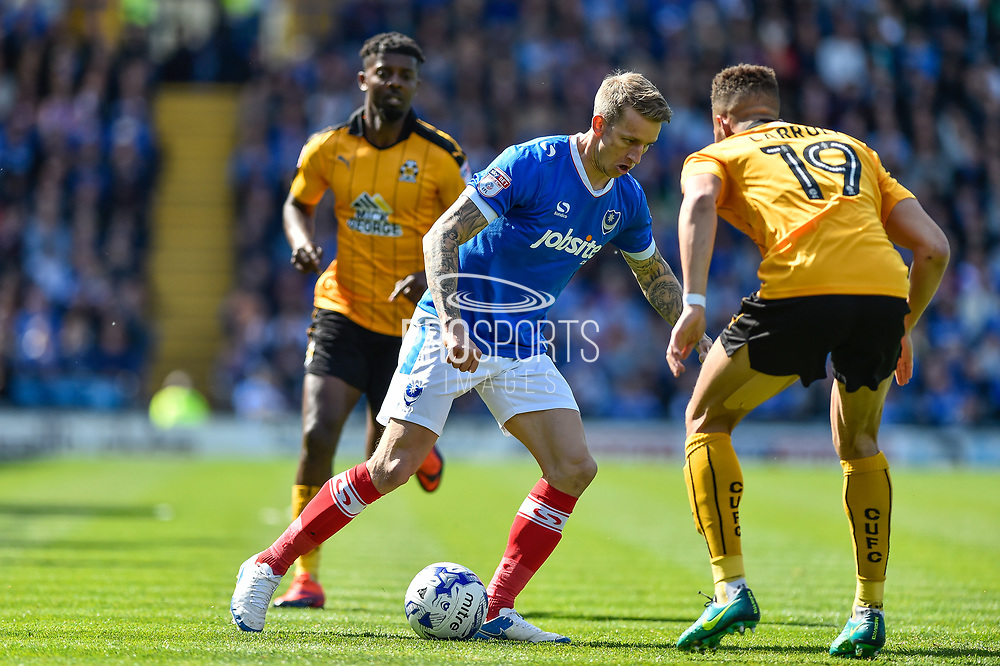 Portsmouth Midfielder, Carl Baker (7) takes on Cambridge United Defender, Jake Carroll (19) during the EFL Sky Bet League 2 match between Portsmouth and Cambridge United at Fratton Park, Portsmouth, England on 22 April 2017. Photo by Adam Rivers.
