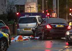 © Licensed to London News Pictures. 11/10/2018. London, UK. A silver blanket covers what is believed a body next to a crashed Mercedes in Hayes. A man is reported to have been shot before fleeing in a Mercedes before it crashed. The driver has been arrested. Photo credit: Ben Cawthra/LNP
