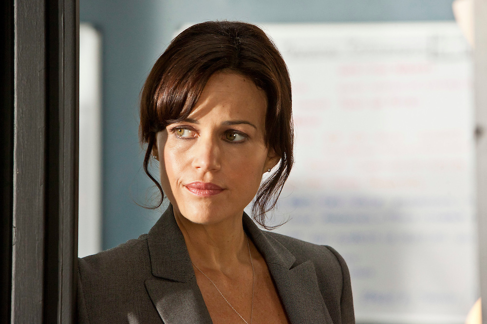 Carla Gugino in 'Hide' from TNT's Mystery Movie Night. Carla Gugino plays Boston Police Detective D.D. Warren, who is called to the grounds of an abandoned mental hospital where a buried chamber is discovered where there are the mummified remains of six young women, who have all been missing for years.