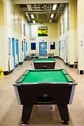 Pool tables for association time, Raleigh wing, HMP/YOI Portland, a resettlement prison with a capacity for 530 prisoners.