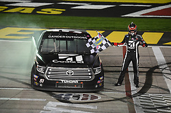March 1, 2019 - Las Vegas, NV, U.S. - LAS VEGAS, NV - MARCH 01: Kyle Busch (51) KBM Toyota Tundra takes the Sunoco checkered flag and waves it over his truck to celebrate the race win during the NASCAR Gander Outdoors Truck Series Strat 200 on March 01, 2019, at Las Vegas Motor Speedway in Las Vegas, NV. (Photo by Chris Williams/Icon Sportswire) (Credit Image: © Chris Williams/Icon SMI via ZUMA Press)
