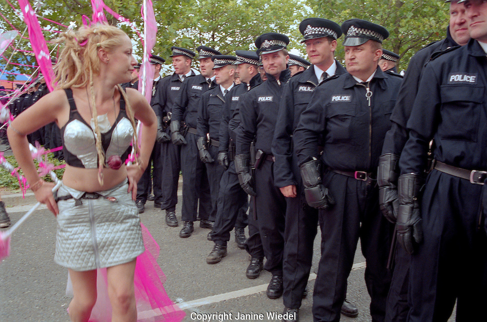 Protesters teasing the police line-up at the Arms trade fair demonstration and march.