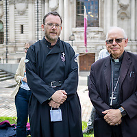 Fr Martin Newell and Bishop Paul Hendricks at Methodist Central Hall at a prayer meeting of the ecumenical group Christian Climate Action during protests urging the government to take urgent action on climate change.