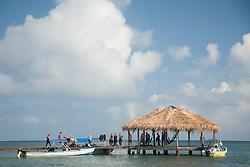 Central America, Honduras, Bay Islands, Roatan, dive boat, dock and thatched palapa, Palmetto Bay Plantation    PR