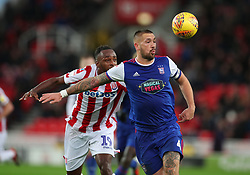 Stoke City's Saido Berahino (left) and Ipswich Town's Luke Chambers battle for the ball