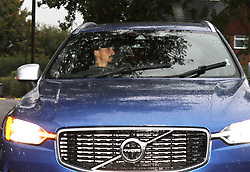 Zlatan Ibrahimovic leaves through the back gate of Carrington in his new Volvo XC60 Hybrid 4x4 while the 1st team were training