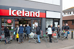©Licensed to London News Pictures 18/03/2020<br /> Petts Wood, UK. Elderly customers queuing round the building this morning at the Iceland store in Petts Wood, Greater London. Iceland stores in the UK have allocated the first two hours of a trading day to the over sixty fives and the vulnerable because of the impact of Coronavirus on food supplies. Photo credit: Grant Falvey/LNP