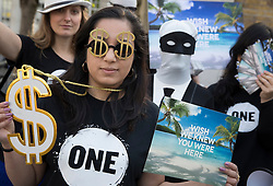 © Licensed to London News Pictures. 12/05/2016. London, UK. Demonstrators protest about corruption outside the anti- corruption summit. Prime Minister David Cameron is hosting a one day summit which is addressing world corruption. Photo credit: Peter Macdiarmid/LNP