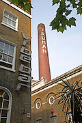 Former Truman brewery building and chimney Brick Lane from outside Vibe bar, East End, London E1, England