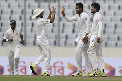 August 28, 2017 - Mirpur, Bangladesh - Bangladesh's Sakib Al Hasan, center, celebrates with his teammates Sabbir Rahman, right, after the dismissal of Australia's Glenn Maxwell  during day two of the First Test match between Bangladesh and Australia at Shere Bangla National Stadium on August 28, 2017 in Mirpur, Bangladesh. (Credit Image: © Ahmed Salahuddin/NurPhoto via ZUMA Press)