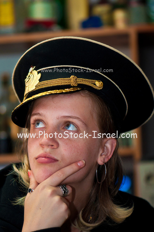 Young blond woman with Russian Army hat