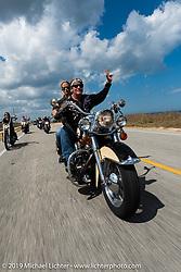 Jay Allen riding his Shovelhead with Danielle VanDeventer along A1A during Daytona Bike Week. FL. USA. Sunday March 18, 2018. Photography ©2018 Michael Lichter.