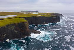 Dramatic cliffs and lighthouse  on coast at Eshaness at Northmavine , north mainland of Shetland Islands, Scotland, UK