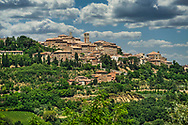 The hillside town of Montepulciano, Italy, founded in the 6th century and built on the top of a Tufa Hill separating two valleys.