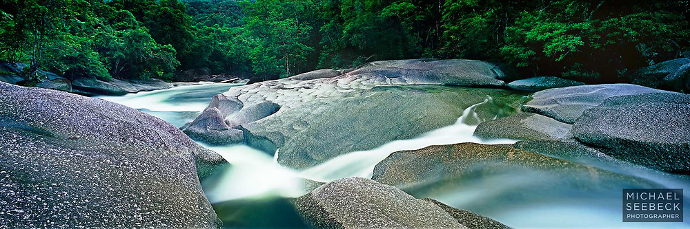 Cool clear rainforest water flows over boulders, smoothed by flowing water over millions of years, at Babinda Boulders.<br /> <br /> Code: HAQT0015<br /> <br /> Limited Edition Print