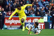 Jordan Botaka of Leeds United is tackled by Jason Davidson of Huddersfield Town. Skybet football league Championship match, Huddersfield Town v Leeds United at the John Smith's Stadium in Huddersfield, Yorks on Saturday 7th November 2015.<br /> pic by Chris Stading, Andrew Orchard sports photography.