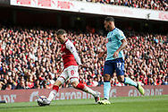 Aaron Ramsey of Arsenal controls the ball under pressure from Joshua King of AFC Bournemouth . Premier league match, Arsenal v AFC Bournemouth at the Emirates Stadium in London on Saturday 9th September 2017. pic by Kieran Clarke, Andrew Orchard sports photography.