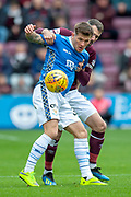 Matthew Kennedy (#33) of St Johnstone FC holds off Michael Smith (#2) of Heart of Midlothian during the Ladbrokes Scottish Premiership match between Heart of Midlothian and St Johnstone at Tynecastle Stadium, Gorgie, Scotland on 29 September 2018.