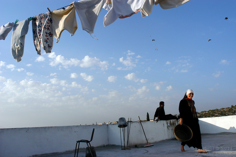 Sameera Toumeh hangs laundry to dry on the roof of her home in the northern West Bank village of Qaffin...Photo by Erin Lubin