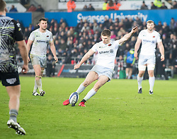 Saracens' Owen Farrell kicks at goal<br /> <br /> Photographer Simon King/Replay Images<br /> <br /> European Rugby Champions Cup Round 5 - Ospreys v Saracens - Saturday 13th January 2018 - Liberty Stadium - Swansea<br /> <br /> World Copyright © Replay Images . All rights reserved. info@replayimages.co.uk - http://replayimages.co.uk