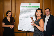 Luciana Berger MP and Stephen Doughty MP look on as  Heidi Allen MP,  signs a declaration at a meeting of a cross-party group of MPs at Church House, London, United Kingdom on 27th August 2019. The declaration states they will continue to meet as an alternative House of Commons if Prime Minister Boris Johnson temporarily shuts down Parliament to get a no-deal Brexit through.