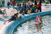 FRANCE, PARIS, CITY CENTER Jardin des Tuileries, the Tuileries Gardens children sailing boats on the lake