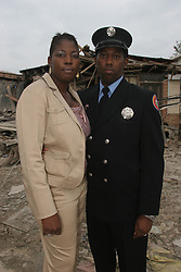 04 Novemebr, 2005.  New Orleans, Louisiana. Post Katrina.<br /> Charles and Camilla visit the lower 9th ward in New Orleans, devastated by hurricane Katrina when a barge broke through the levee flooding the area. Local residents Tommy Jones and his wife Ginia who lost everything in the storm. Ginia gave Camilla a Mardi Gras doll to remind her of New Orleans.<br /> Photo; Charlie Varley/varleypix.com