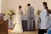 bride and groom lighting the unity candle by Tallmadge wedding photographer, Akron wedding photographer Mara Robinson Photography