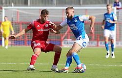 Dan Butler of Peterborough United takes on Dion Charles of Accrington Stanley - Mandatory by-line: Joe Dent/JMP - 12/09/2020 - FOOTBALL - Wham Stadium - Accrington, England - Accrington Stanley v Peterborough United - Sky Bet League One