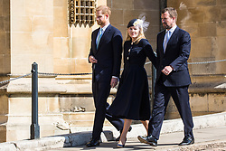 Windsor, UK. 21st April 2019. The Duke of Sussex and Peter and Autumn Phillips arrive to attend the Easter Sunday service at St George's Chapel in Windsor Castle.