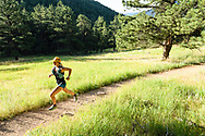 Jade Schwarting trail running on Lion's Lair Trail in Boulder, CO. © Brett Wilhelm