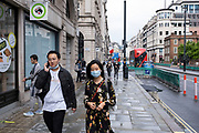 Face masks on Piccadilly under coronavirus lockdown on 1st July 2020 in London, England, United Kingdom. As the July deadline approaces and government will relax its lockdown rules further, the central London remains very quiet, while some non-essential shops are allowed to open with individual shops setting up social distancing systems.
