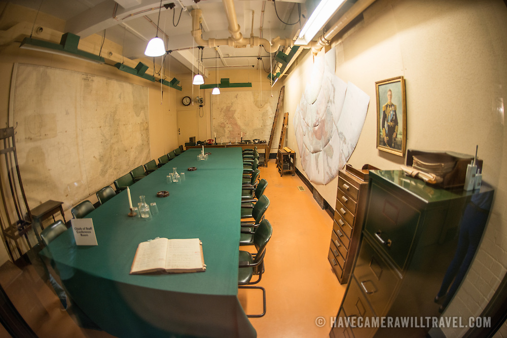 The Chiefs of Staff Conference Room at the Churchill War Rooms in London. The museum, one of five branches of the Imerial War Museums, preserves the World War II underground command bunker used by British Prime Minister Winston Churchill. Its cramped quarters were constructed from a converting a storage basement in the Treasury Building in Whitehall, London. Being underground, and under an unusually sturdy building, the Cabinet War Rooms were afforded some protection from the bombs falling above during the Blitz.