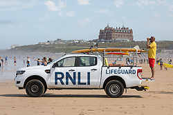 © Licensed to London News Pictures. 31/07/2020. Newquay, UK. RNLI Lifeguards patrol Fistral Beach, Cornwall, on a very hot day in the southwest. Parts of the country are expected to have the hottest day of the year so far. Photo credit : Tom Nicholson/LNP