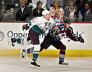 The Colorado Avalanche's Alex Tanguay (#18) collides with the Anaheim Mighty Ducks' Vitaly Vishnevski (#5) along the boards during the first period of their game Tuesday May 9, 2006 at the Pepsi Center. The Colorado Avalanche ended their scoreless drought against the Mighty Ducks with a goal by Dan Hinote in the closing minute of the first period. Neither were injured in the collision..(MARC PISCOTTY/ © 2006)