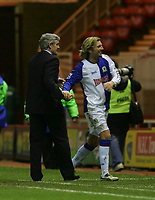 Photo: Andrew Unwin.<br /> Middlesbrough v Blackburn Rovers. Carling Cup. 21/12/2005.<br /> Blackburn's manager, Mark Hughes (L), with Robbie Savage (R) at the end of the game.
