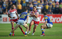 Leeds Rhinos Ash Handley (left) and Matt Parcell (right) tackle Leigh Centurions Bodene Thompson during the Ladbrokes Challenge Cup, quarter final match at the LD Nutrition Stadium, Featherstone.