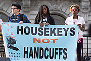 """San Francisco, USA. 19th January, 2019. The Women's March San Francisco begins with a rally at Civic Center Plaza in front of City Hall. Three young people hold a banner on stage reading: """"Housekeys Not Handcuffs,"""" as representatives from the Coalition on Homelessness speak about the plight of homeless women in San Francisco. Credit: Shelly Rivoli/Alamy Live News"""