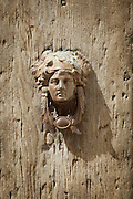 An old door knocker on a building in the Piazza del Montepulciano in Tuscany, Italy