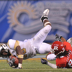Dec 19, 2009; St. Petersburg, Fla., USA; Rutgers wide receiver Marcus Cooper (84) reacts to UCF defensive back Kemal Ishmael's (18) interception during NCAA Football action in Rutgers' 45-24 victory over Central Florida in the St. Petersburg Bowl at Tropicana Field.