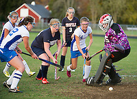 Gilford's Kelsey Buckley assisted by Laura Zakorchemny score a goal past Profile's #95/Jones during NHIAA DIvision III Field Hockey Friday afternoon.   (Karen Bobotas/for the Laconia Daily Sun)