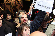 Dozens of protestors descended on Top Shop to highlight the inequity of the alleged tax avoidance by Sir Philip Green London, UK, 4/12/2010
