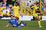 AFC Wimbledon midfielder David Fitzpatrick (19) tackling Bristol Rovers striker Byron Moore (22) during the EFL Sky Bet League 1 match between AFC Wimbledon and Bristol Rovers at the Cherry Red Records Stadium, Kingston, England on 8 April 2017. Photo by Matthew Redman.